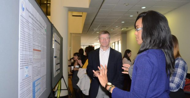 Graduate Seminar Student Nonye A. O. Nwosu describes her research to Dr. Warren